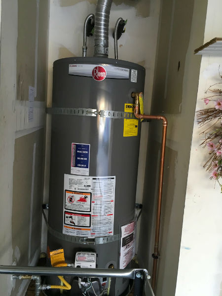 Tracy Leaking 50 Gallon Water Heater and Replacement